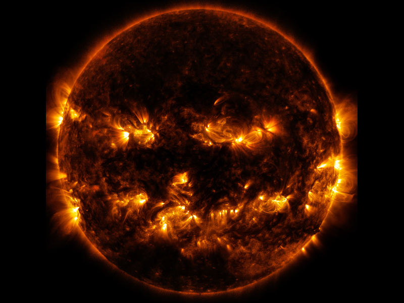 Solar activity creates frightening jack-o-lantern face (photos)
