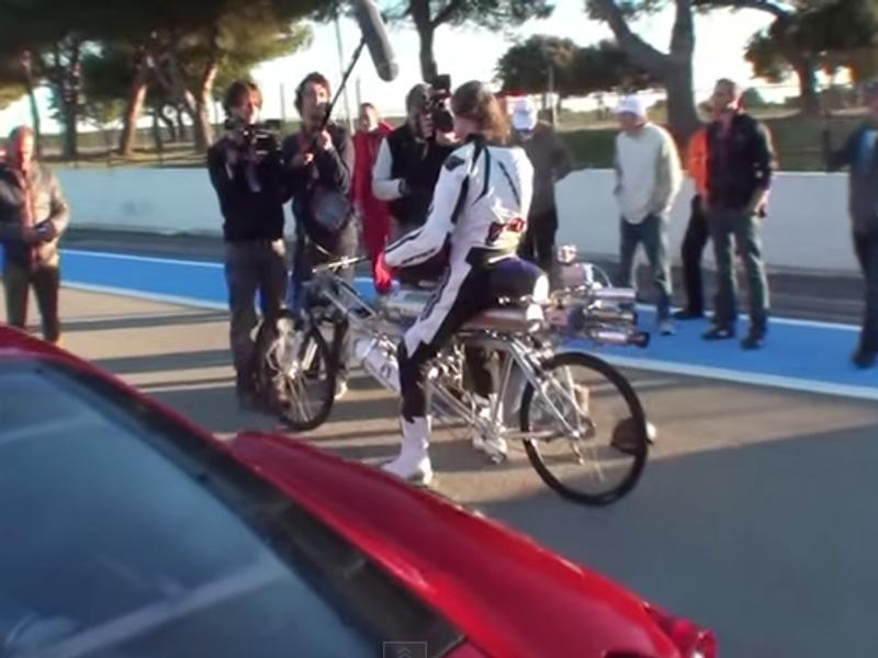Rocket bicycle beats Ferrari at 333 km/h (video)