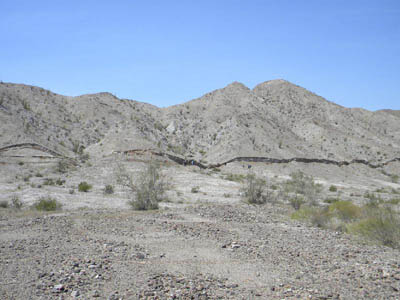 This five-foot-high (1.5-meter-high) surface rupture, called a scarp, formed in just seconds along the Borrego fault during the magnitude 7.2 El Mayor Cucapah earthquake in northern Baja California on 4 April 2010. NASA says topographic surveys of the surrounding landscape reveal the complexity of earthquake deformation, including how this fault interacted with adjacent faults. Image credit: Centro de Investigacion Cientifica y de Educacion Superior de Ensenada (CICESE)