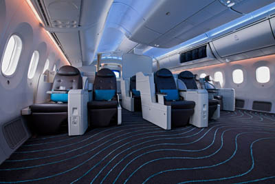 Futuristic aspects of the Boeing Dreamliner include a business-class cabin with 12 lay-flat seats