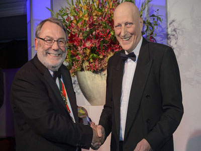 Colin Latimer (right) pictured receiving his award from Sir Peter Knight, president of the Institute of Physics