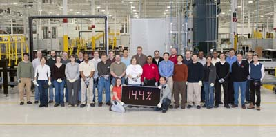 First Solar employees pictured holding the company's record-breaking 14.4pc efficient module, manufactured in Perrysburg, Ohio