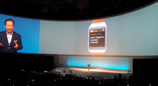 Samsung Mobile head JK Shin receives a notification from his Galaxy Gear smartwatch during the Samsung Unpacked event in Berlin
