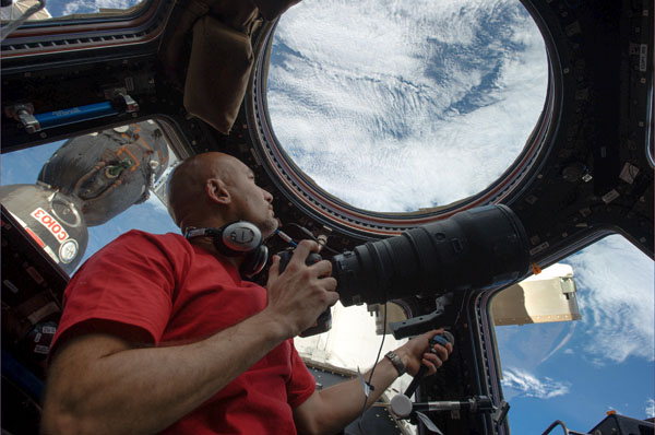 Italian astronaut Luca Parmitano pictured getting ready to take a picture of Earth from 400km high on the International Space Station. In this photo, Luca is in ESA's Cupola module that is used to monitor approaching spacecraft but also a window to our planet. Credit: ESA/NASA