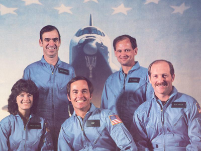 Ride, front row, left, with her STS-7 crewmates. In addition to launching America's first female astronaut, NASA said it was also the first mission with a five-member crew. Front row, from left: Ride, Commander Bob Crippen, Pilot Frederick Hauck. Back row, left to right: John Fabian, Norm Thagard 