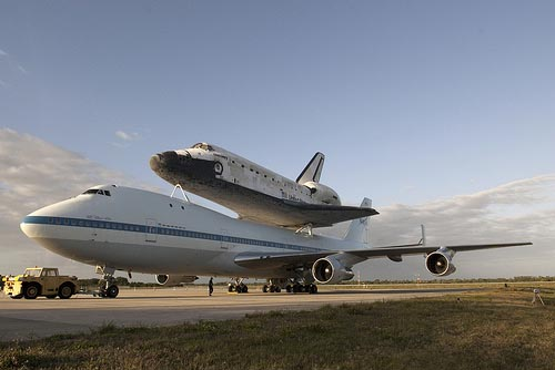 NASA Discovery shuttle pictured mounted on a modified Boeing 747 carrier at the Shuttle Landing Facility at NASA's Kennedy Space Center in Florida before its final flight to the Smithsonian today. The shuttle will be placed on display in the Smithsonian's National Air and Space Museum Steven F. Udvar-Hazy Center. Image credit: NASA/Tim Jacobs