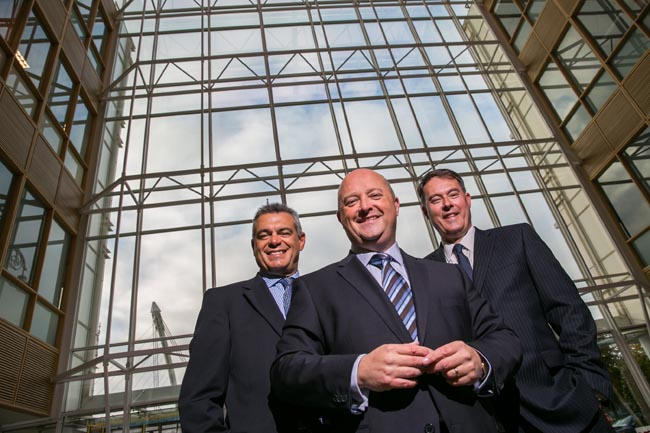 Riccardo Brizzi, chief operating officer, SQS Group; Phil Codd, managing director, SQS Ireland; and Dik Vos, CEO, SQS Group; pictured at the company's new offices in the Dublin Docklands this morning. SQS's Irish operation has its sights set on creating 75 jobs over the coming three years - at both its Dublin and Belfast hubs. Image credit: Naoise Culhane Photography