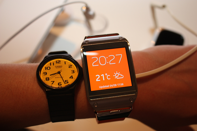 The Samsung Galaxy Gear sizing up next to a traditional wristwatch