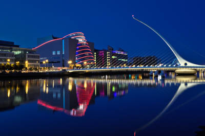 Night-time vista of the Samuel Beckett Bridge, Dublin, which spans the River Liffey, with The Convention Centre Dublin in the background. The photo is available on Lokofoto.com. Photographer: Paul Sweeney