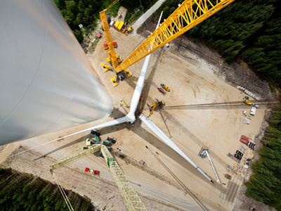The Siemens rotor, which consists of three 75-metre rotor blades and has a diameter of 154 metres, pictured being assembled on the ground at the Østerild test centre in Denmark. Image via Siemens