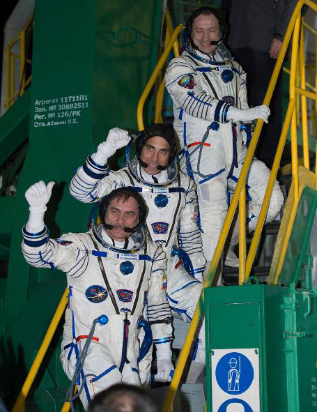 The Expedition 35 crew pictured waving farewell yesterday from the base of the Soyuz rocket at the Baikonur Cosmodrome in Baikonur, Kazakhstan. From top: Russian flight engineer Alexander Misurkin, NASA flight engineer Chris Cassidy and Soyuz commander Pavel Vinogradov. Photo Credit: NASA/Carla Cioffi
