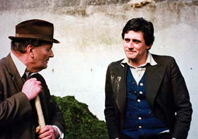 Irish actors John Crowley as Tom Riordan and Gabriel Byrne as Pat Barry in the RTÉ rural serial 'The Riordans, which ran until 1979. The TV series helped catapult Byrne into hollywood stardom where he has since played leading roles and become an Academy Award nominated producer and a Tony Award nominated stage actor. Image credit: RTÉ Television Library
