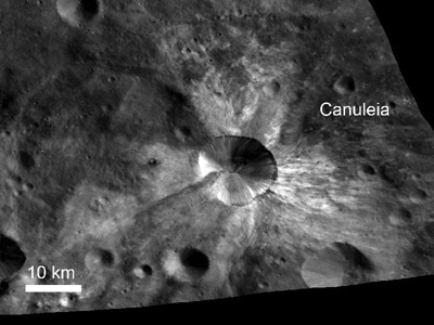 In this image from NASA's Dawn spacecraft, the scientists said bright material extends out from the crater Canuleia on Vesta. The bright material appears to have been thrown out of the crater during the impact that created it, they said. Image credit: NASA/JPL-Caltech/UCLA/MPS/DLR/IDA/UMD