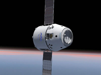 Dragon depicted in orbit, with its retractable solar panels. Image courtesy of SpaceX