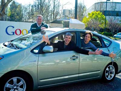 Eric Schmidt, executive chairman; Google; Larry Page, CEO, and Sergey Brin, co-founder, in the Google self-driving hybrid car