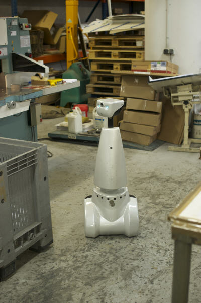 Jazz robot surveying a factory floor