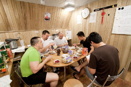The Mars500 crew eating in the simulated spacecraft