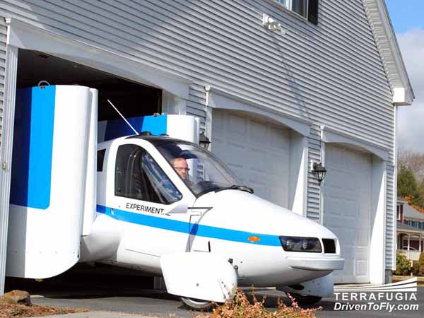 Terrafugia's prototype of its Transition flying car pictured leaving a garage in Massachusetts. Image courtesy of Terrafugia