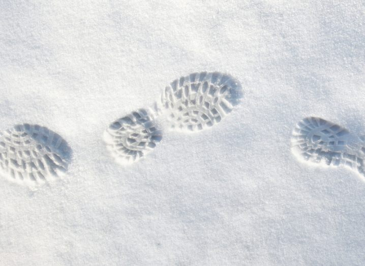 fresh shoeprints in white snow.