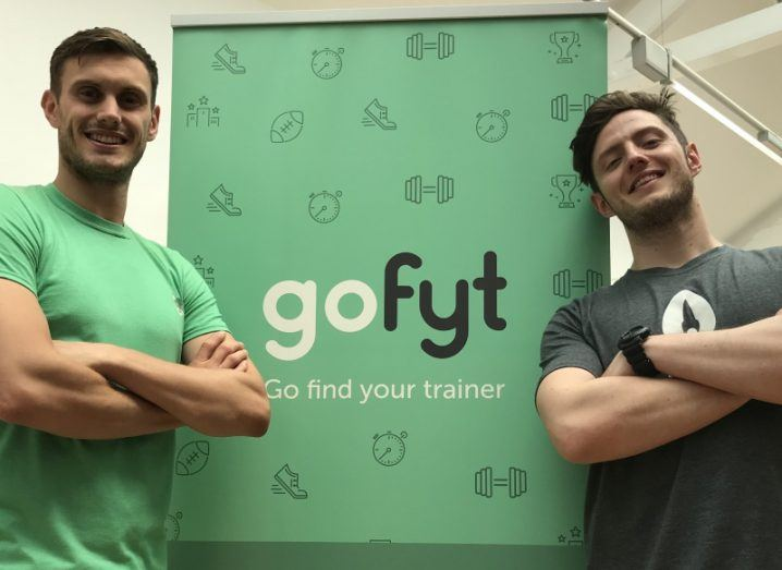 gofyt founders folding arms in front of green gofyt sign
