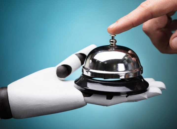 robot holding a reception bell
