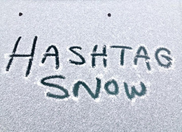 Hashtag snow written in snow