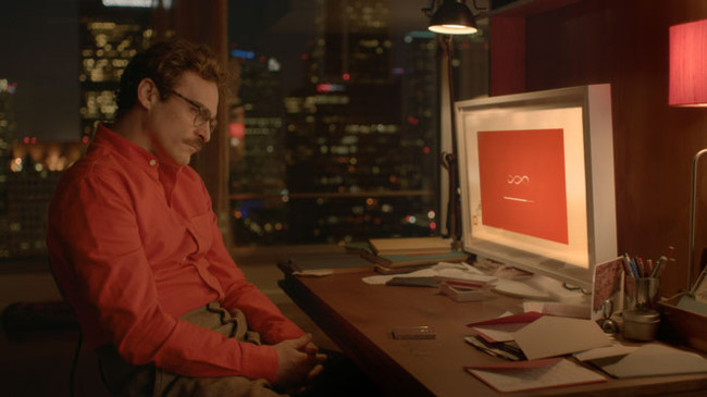 Joaquin Phoenix in the movie Her, where he forges a relationship with an artificially intelligent operating system. Abosch believes that his CHARLIE AI technology will bring technology like that seen in Her to life.
