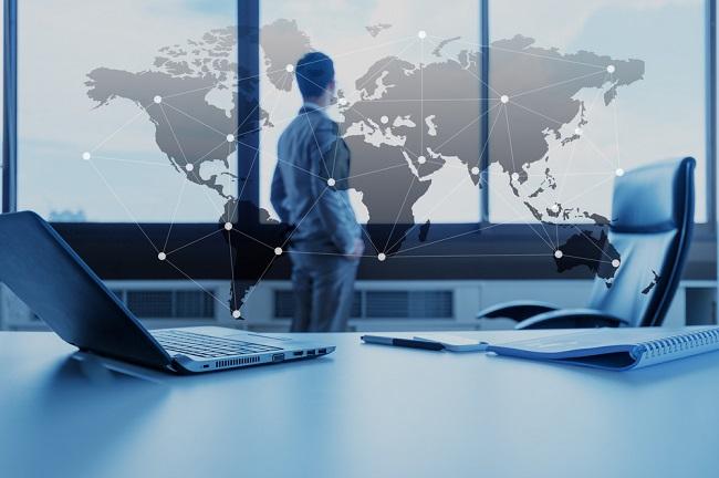 Man monitoring world map