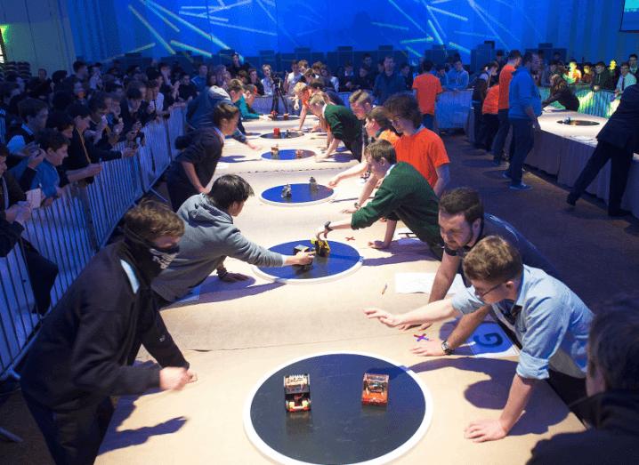Children competing in Mini Sumo war