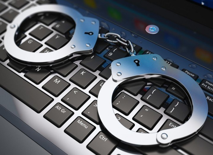 Handcuffs on computer keyboard