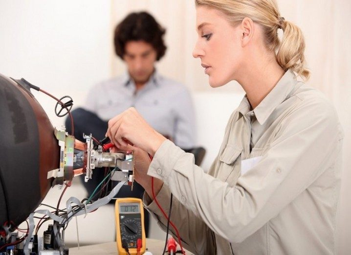 Woman working with electronics