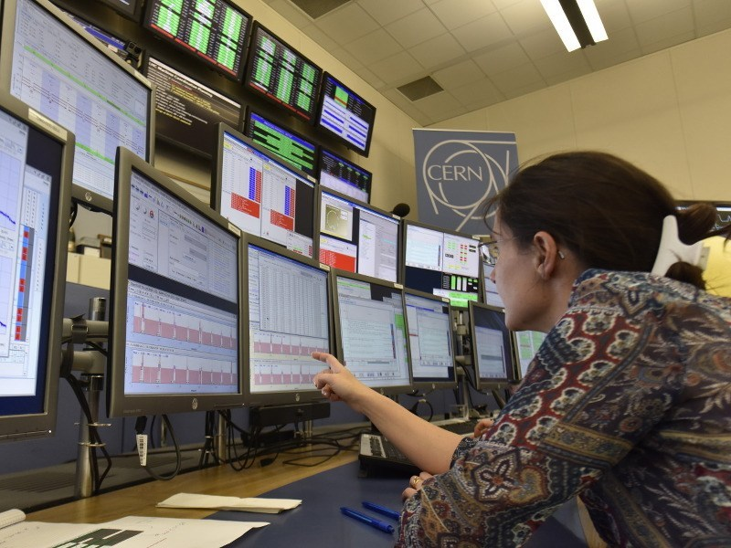 One of the LHC operators, Laurette Ponce, analyses the many screens of data that physicists use to monitor and operate the machine, via M.Brice/CERN