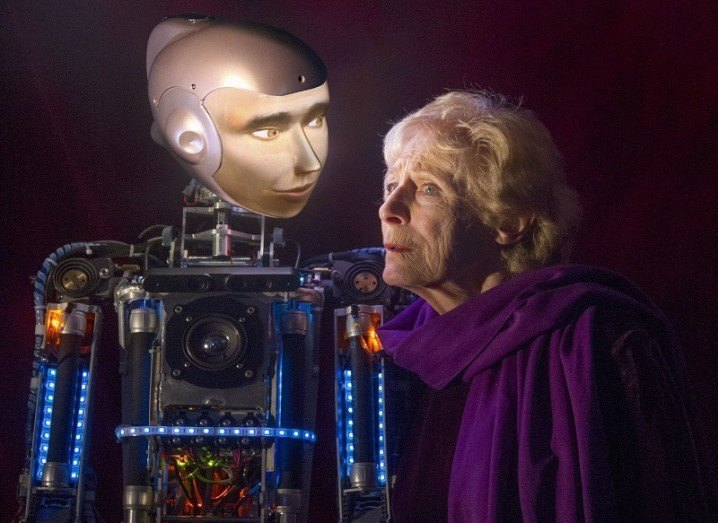 Spillikin play with robot and elderly woman
