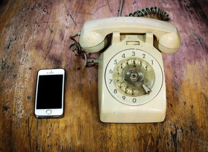 iPhone with old telephone