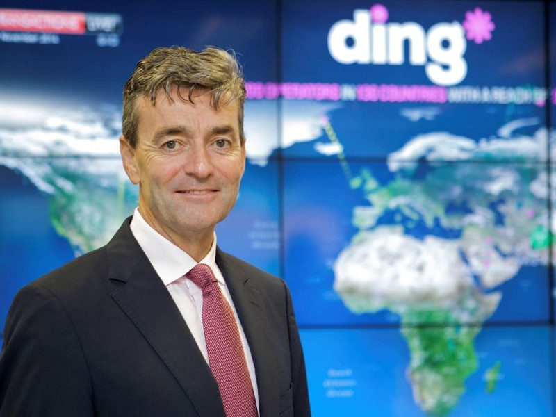 Picture of Ding founder Mark Roden in front of a global map.