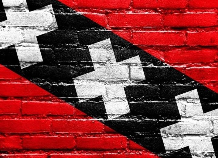 Amsterdam flag on brick wall
