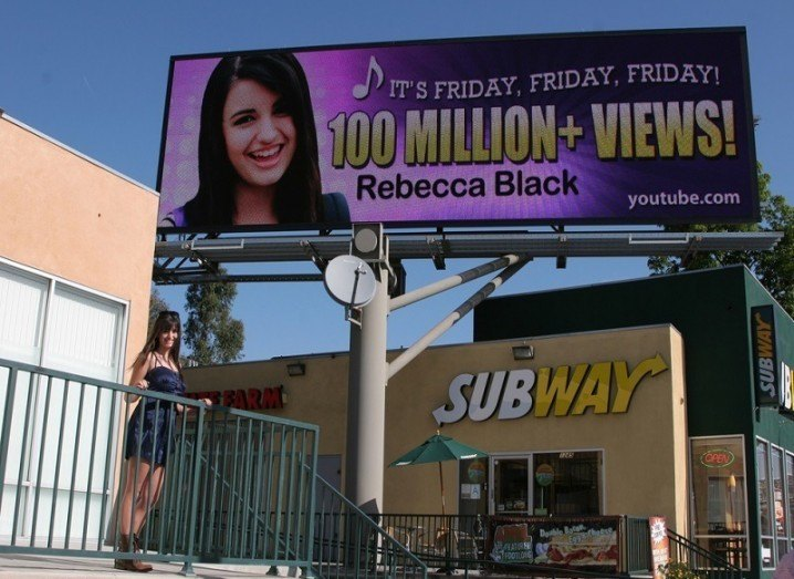 Rebecca Black with advertising board