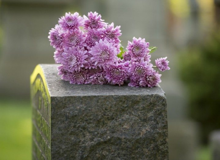 Gravestone image by Jeff Wasserman via Shutterstock