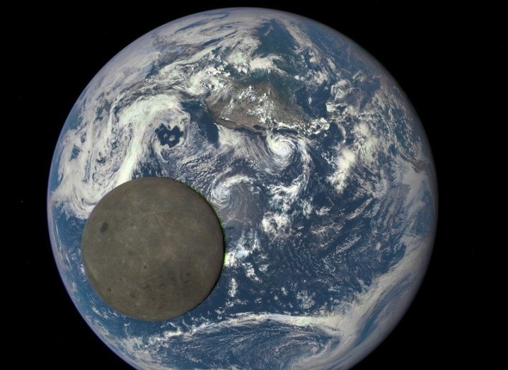 Moon crossing Earth image