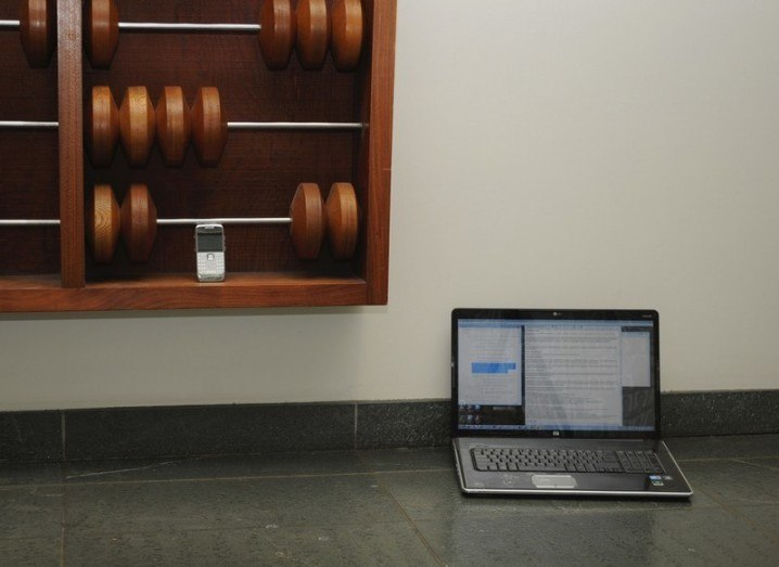 Fintech Week - laptop evolution smartphone abacus