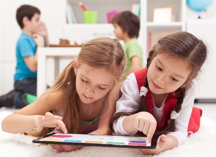 Intel Education Accelerator: two young girls using a tablet