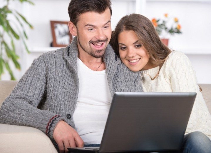 Pornhub Premium: Couple watching something on a laptop