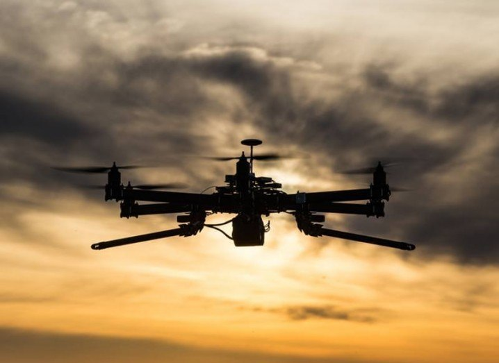 Drones: drone flying into sunset