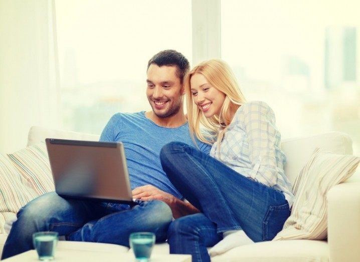 Netflix: couple watching something on laptop