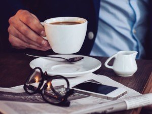 Newspaper and a smartphone   Facebook Notify