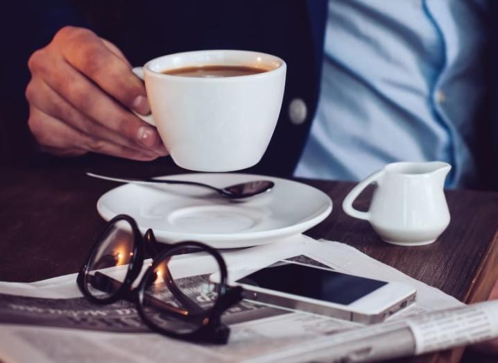 Newspaper and a smartphone | Facebook Notify