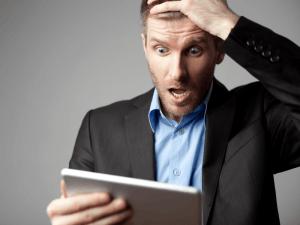 Google: shocked man using tablet