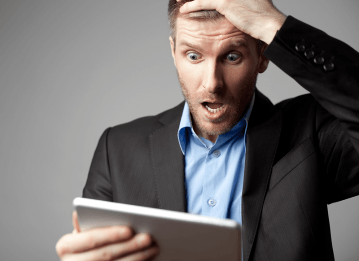 Google: shocked man using tablet