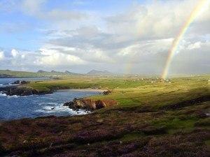Ireland: rocky cliffs under a rainbow