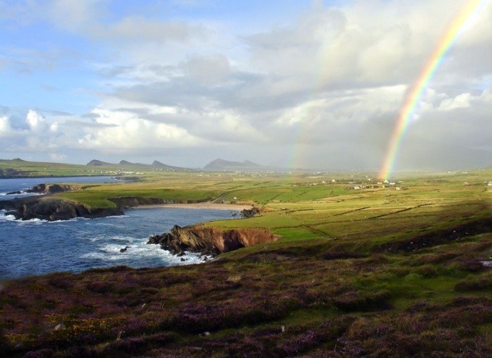 Ireland: rocky cliffs under a rainbow